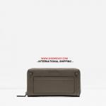 กระเป๋าสตางค์ CHARLES & KEITH STUDDED FRONT POCKET WALLET CK6-10770235 ทรงใบยาว รุ่นใหม่