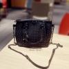 กระเป๋าสะพายข้าง Magic bag ตกแต่งด้วยหมุดทั้งใบ สีMatte black หนังทรงสวย ขนาดกระทัดรัด ดีไซน์เท่ห์ เกร๋ ใช้งานง่าย ช่องใส่ของเยอะ มาพร้อมสายยาว