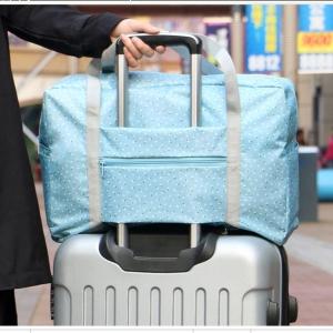 DINIWELL กระเป๋าเดินทางพับเก็บได้ อเนกประสงค์ เพื่อการเดินทาง ท่องเที่ยว ปรับสายสะพายได้ เสียบที่จับของกระเป๋าเดินทางได้ น้ำหนักเบา มีซิปรูดตอนพับเก็บ