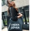 กระเป๋าหนังเทียมสีดำ uncover