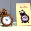D00067 นาฬิกาตุ๊กๆยกล้อ
